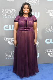 Octavia Spencer chose a short-sleeve purple gown by Tadashi Shoji for her 2018 Critics' Choice Awards look.
