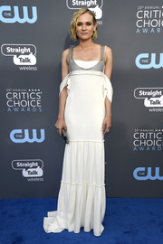 Diane Kruger went for edgy glamour in a white Vera Wang cold-shoulder gown with chainmail detailing at the 2018 Critics' Choice Awards.