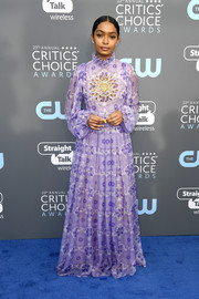 Yara Shahidi went demure in a lilac Giambattista Valli Couture print gown with long sleeves and a high ruffle neckline at the 2018 Critics' Choice Awards.