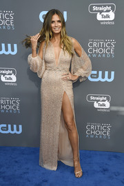 Heidi Klum teamed her dress with gold ankle-strap sandals by Stuart Weitzman.