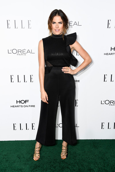 Karla Souza went the modern route in an asymmetrical black jumpsuit by Self-Portrait for her Elle Women in Hollywood Awards look.