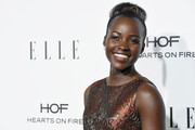 Lupita Nyong'o styled her natural curls into a bun for the Elle Women in Hollywood Awards.