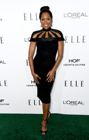 Regina King sported an eye-catching Christian Siriano LBD, featuring a unique multi-cutout yoke, at the Elle Women in Hollywood Awards.