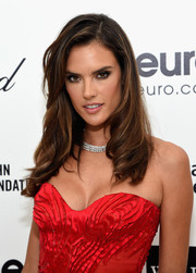 Alessandra Ambrosio styled her tresses with demure waves for Elton John's Oscar-viewing party.