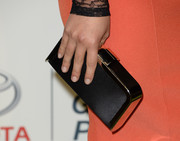 Hayden Panettiere finished off her Environmental Media Awards ensemble with a classy black satin clutch with gold hardware.