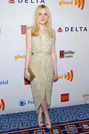 Dakota Fanning added pair of metallic gold sandals to her glimmering ensemble at the 23rd Annual GLAAD Media Awards.