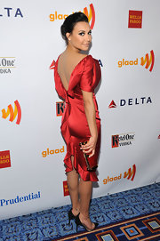 Naya Rivera carried this red and gold clutch to the GLAAD Awards.