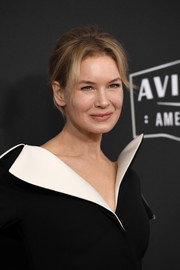 Renee Zellweger opted for a loose bun with parted bangs when she attended the 2019 Hollywood Film Awards.