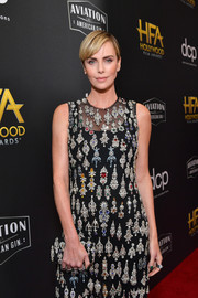 Charlize Theron matched her clutch to her beaded outfit when she attended the 2019 Hollywood Film Awards.