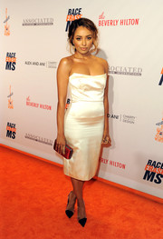 Kat Graham polished off her look with a red satin clutch by Yliana Yepez.