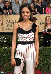 Naomie Harris accessorized with a black satin envelope clutch by Tyler Ellis at the SAG Awards.