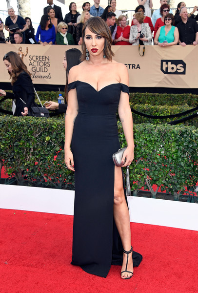 Jackie Cruz paired her elegant dress with black T-strap sandals.