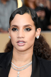 Dascha Polanco attended the SAG Awards wearing a dramatic 'do that was slicked down in a finger wave style at the top and voluminous and curly down the ends.