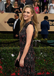 Teresa Palmer hit the SAG Awards red carpet sporting a black velvet clutch and embellished gown combo.