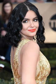 Ariel Winter looked radiant with her bright orange lipstick.