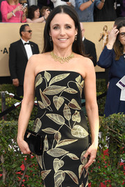 Julia Louis-Dreyfus paired a black velvet clutch with a leaf-motif strapless dress for her SAG Awards look.