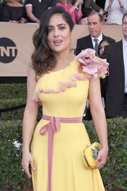 Salma Hayek attended the SAG Awards sporting a yellow-on-yellow clutch and gown combo.