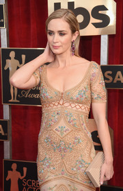 Emily Blunt paired a nude Lee Savage box clutch with a beaded dress for the SAG Awards.