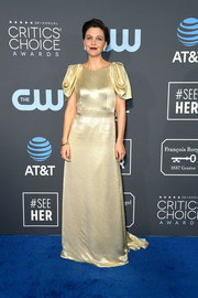 Maggie Gyllenhaal got glam in a gold Prada gown with sculptural sleeves for the 2019 Critics' Choice Awards.