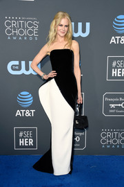 Nicole Kidman completed her look with a boxy satin wristlet by Moynat.