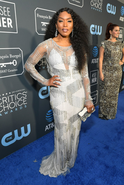Angela Bassett continued the sparkle with a silver clutch by Emm Kuo.