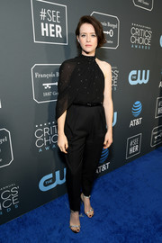 Claire Foy styled her look with a pair of bedazzled silver sandals by Jimmy Choo.