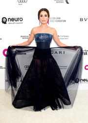 Lea Michele was a head turner at the Elton John AIDS Foundation Oscar viewing party in a Pamella Roland strapless gown with an embellished bodice, a sheer skirt, and a cinched-in waist.