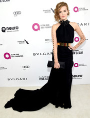 Maggie Grace glammed it up in a black fishtail gown with illusion sleeves and a gold belt at the Elton John AIDS Foundation Oscar viewing party.