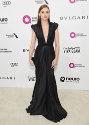 Holland Roden made an ultra-chic choice with this plunging, pleated black gown by Gomez-Gracia for the Elton John AIDS Foundation Oscar viewing party.