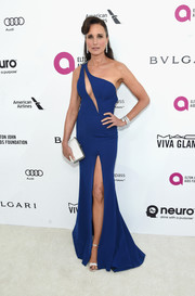 Andie MacDowell got majorly vampy in a blue one-shoulder gown with a slashed bodice and a high slit for the Elton John AIDS Foundation Oscar viewing party.
