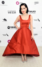Dita Von Teese was ultra glam, as always, in a red fit-and-flare gown by Zac Posen at the Elton John AIDS Foundation Oscar viewing party.