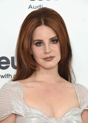 Lana Del Rey attended the Elton John AIDS Foundation Oscar viewing party rocking a long bouffant.