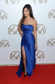 Hannah Simone stole the spotlight in this stunning royal blue gown. The cinched waist and thigh-high slit accentuated the actress' killer figure. Who knew satin could be so darn flattering?