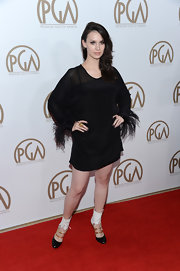 Alixandra von Renner had the most fun at the PGAs in this black feathered dress. Her footwear, amazingly, was an even more adventurous choice.