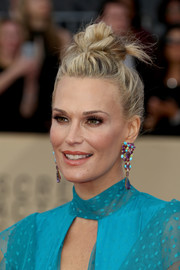 Molly Sims accessorized with chunky gemstone chandelier earrings by Leticia Linton.