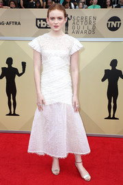 Sadie Sink kept it sweet and youthful in a textured white Chanel dress with pleated cap sleeves at the 2018 SAG Awards.