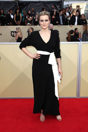 Taylor Schilling was classic in a black Diane von Furstenberg wrap gown with a contrast belt at the 2018 SAG Awards.