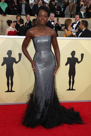 Lupita Nyong'o got glam in a strapless, feather-hem mermaid gown by Ralph & Russo Couture for the 2018 SAG Awards.