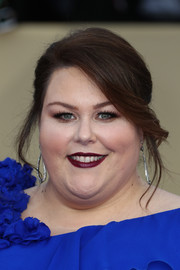 Chrissy Metz got glammed up with this loose bun for the 2018 SAG Awards.