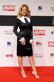 Barbara Schoeneberger looked chic in a sleek skirt suit with a menswear-inspired tie at the German Auto Trophy Awards.