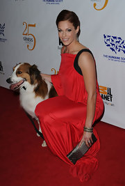 Amanda Righetti complemented her striking red gown with a glamorous pewter clutch embellished with an array of crystals.