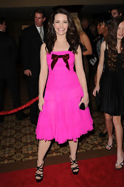 Kristin Davis gave her frothy pink dress a sultry edge with black patent criss cross platform sandals.