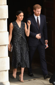 Meghan Markle looked simply stylish in a speckle-print midi dress by Boss at the 25th anniversary memorial service celebrating Stephen Lawrence.