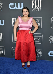 Beanie Feldstein coordinated her look with red platform sandals by Jimmy Choo.