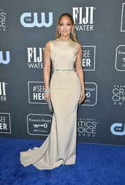 Jennifer Lopez went for minimalist elegance in a sleeveless nude fishtail gown by Georges Hobeika at the 2020 Critics' Choice Awards.