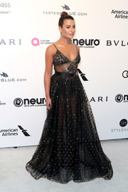 Lea Michele bared some skin in a sheer black polka-dot gown by Elie Saab at the Elton John AIDS Foundation Oscar-viewing party.