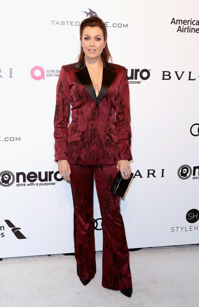 Bellamy Young went for some '70s groove with this burgundy bell-bottom pantsuit by Dani Kurrle at the Elton John AIDS Foundation Oscar-viewing party.