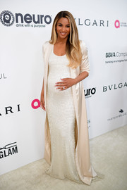 Ciara oozed elegance in a textured white maternity dress by August Getty Atelier at the Elton John AIDS Foundation Oscar-viewing party.