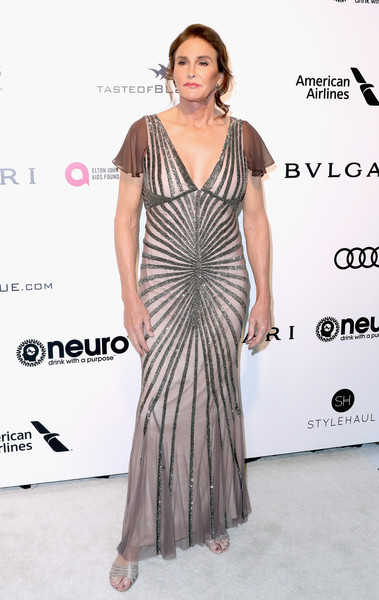 Caitlyn Jenner got dolled up in a beaded mauve gown by Rachel Gilbert for the Elton John AIDS Foundation Oscar-viewing party.