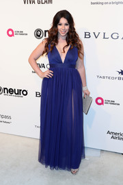 Jillian Rose Reed went bold in a deep-V cobalt gown with a semi-sheer skirt at the Elton John AIDS Foundation Oscar-viewing party.
